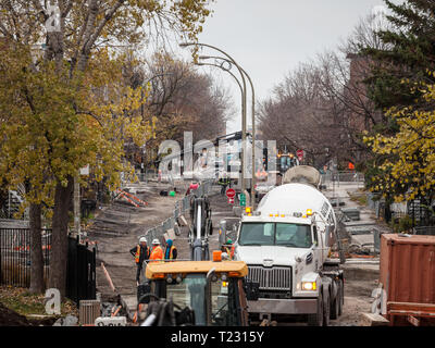 MONTREAL, CANADA - NOVEMBER 10, 2018: Construction site in le Plateau district, a street asphalt reconstructionm with trucks, craners and construction - Stock Image