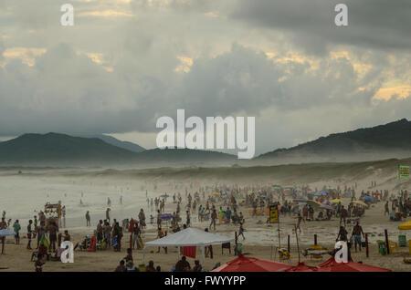 beach full of people during peak season - Stock Image