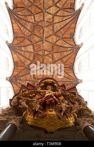 The ceiling of the St Bavo Church in Haarlem, the Netherlands. The wooden ceiling features vaulted arches. - Stock Image