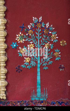 Mosaic tree decorating an external wall, Temple Wat Souvannakhirii, Luang Prabang, Laos - Stock Image