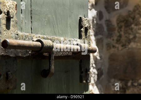 Close up of old rusty latch on the door of  Mission Espada, Texas USA - Stock Image