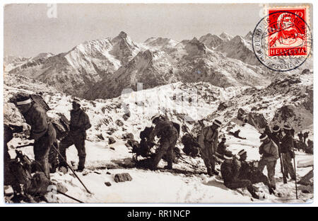Swiss postcard of Alpine scene with group of climbers, dated 1917. - Stock Image