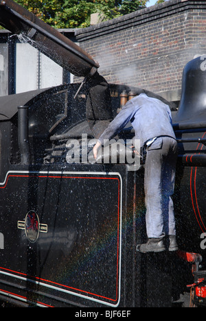 Rainbow while filling the A.J.Hill designed 0-6-2T tank engine at Sheringham Station on the North Norfolk Railway. - Stock Image