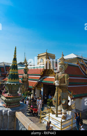 Statues in Wat Phra Kaew Temple of the Emerald Buddha, Grand Palace, Bangkok, Thailand - Stock Image