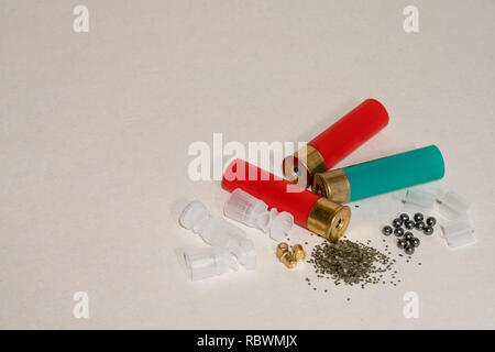 Casings, gunpowder, shot capsules on light background - Stock Image