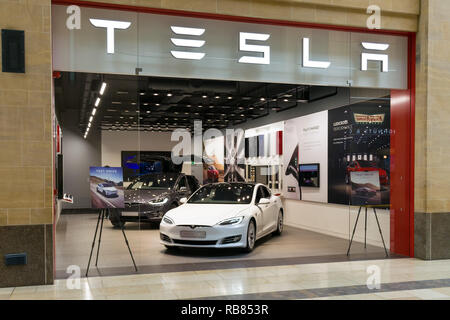 View of the Tesla showroom in the Grand Arcade with Model S electric vehicles on display, Cambridge, UK - Stock Image