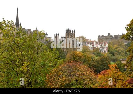 Autumn bringing colour to the Mound, Princes Street Gardens looking toward New College, Edinburgh University, Scotland, UK, Europe - Stock Image
