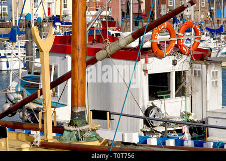 A busy, colourful abstract of boats berthed in Arbroath harbour, Angus, Scotland. - Stock Image