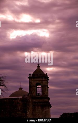 Mission San Jose bell tower san antonio texas tx early morning dramatic purple sky silo silhouette - Stock Image