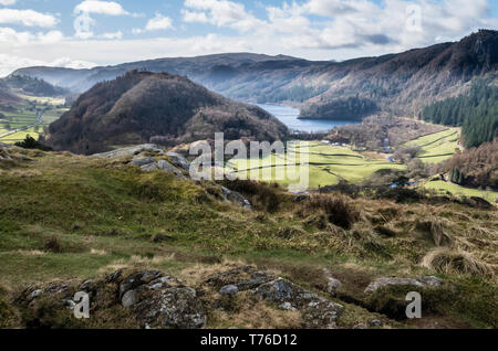 English lake district. A distant view of Thirlmere from High Rigg with a mountainous backdrop on a sunny day. - Stock Image