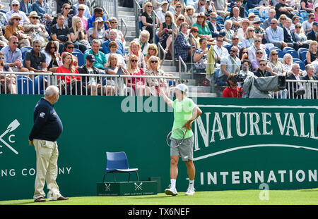 Eastbourne, UK. 24th June, 2019. John Millman of Australia appears to be frustrated with a section of the centre court crowd during his match against Fernando Verdasco of Spain at the Nature Valley International tennis tournament held at Devonshire Park in Eastbourne . Credit: Simon Dack/Alamy Live News - Stock Image