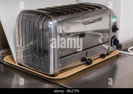 Dualit six slice toaster on a stainless steel counter in the kitchen of a hospital ward. - Stock Image