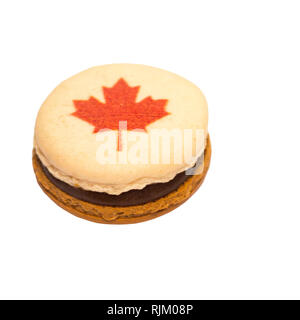 Macaron decorated with red maple leaf for Canada Day - Stock Image