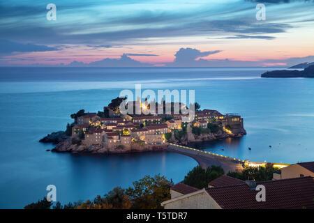 View of Sveti Stefan island at dusk, Montenegro - Stock Image