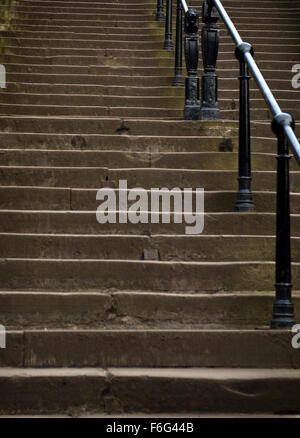 Stone steps and iron posts and rails leading to Calton Hill in Edinburgh - Stock Image