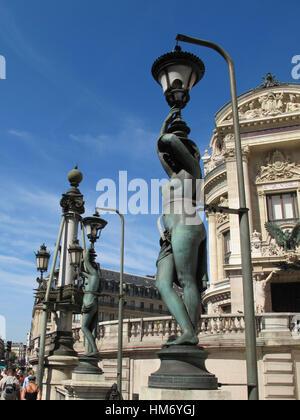 Bronze statues facing Opera Garnier, Paris - Stock Image