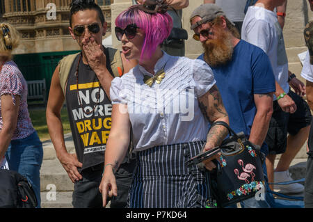 London, UK. 6th July 2018. A member of the group 'We The Undersigned Have a Legal Right to use Cannabis' identifies a man who has just assaulted a protest as Derek White who they have outed for selling fake cannabis oil to people desperate to cure various conditions. The protest in Old Palace Yard was in support of Newport West Labour MP Paul Flynn's Private Member's Bill to allow the medical use of cannabis was expected to be debated this afternoon. Credit: Peter Marshall/Alamy Live News - Stock Image
