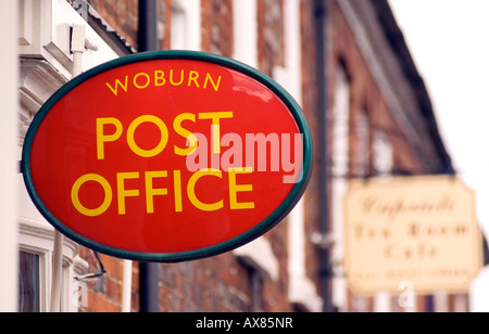 rural village post office sign at Woburn old post box Save our post office - Stock Image