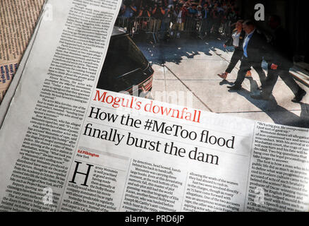 Harvey Weinstein article 'Mogul's downfall How the #MeToo flood finally burst the dam' in the Guardian newspaper London England UK - Stock Image