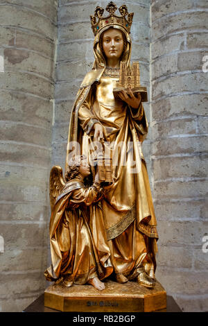Statue of Saint Gudula in the Cathedral of St. Michael and St. Gudula, Bruxelles, Belgium - Stock Image
