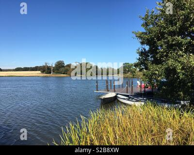 View of the lake in the grounds of Holkham Hall, Norfolk . - Stock Image