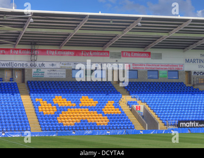The stands Wolf print in yellow stand at Warrington Wolves Rugby Stadium, Cheshire England UK - Stock Image