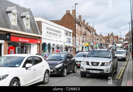Uckfield East Sussex England UK - Traffic and pedestrians in the High Street - Stock Image