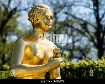 Golden Skuptur, warrior with shield and sword, Herrenhausen Gardens,  Baroque garden at castle Herrenhausen, Hanover, - Stock Image