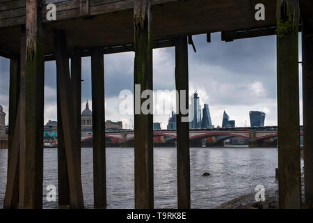 City of London panorama photographed from River Thames Beach at low tide 18 May 2019. London England St Paul's Cathedral, Faraday Building (White with - Stock Image