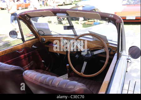 Dashboard, instrumentation, steering wheel and front seats. 1951 Riley Drophead Special vintage motor car. - Stock Image