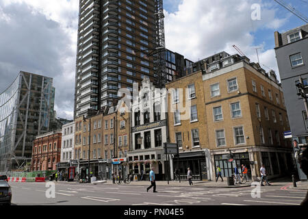 Street view of Norton Folgate and high rise modern Principal Tower in the City of London near Spitalfields East London England  UK  KATHY DEWITT - Stock Image