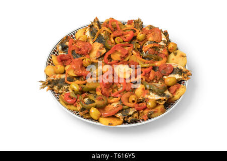 Traditional  Moroccan dish with sardines and vegetables isolated on white background - Stock Image