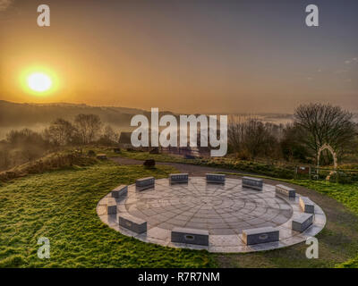 Wirksworth, Derbyshire Dales, Peak District, UK. 11th December, 2018. UK Weather: spectacular sunrise with cloud inversion at the star disc above Wirksworth in the Derbyshire Dales, Peak District National Park Credit: Doug Blane/Alamy Live News - Stock Image