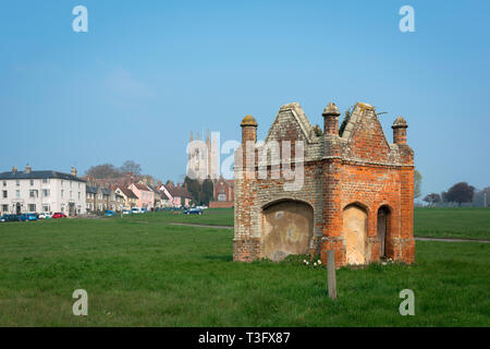 Long Melford Suffolk, view of The Green in Long Melford village with a Tudor brick water conduit in the foreground, Suffolk, England, UK. - Stock Image