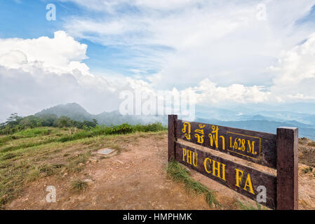 Nameplate attractions viewpoint and blue sky with white cloud above high mountain at Phu Chi Fa Forest Park in Chiang - Stock Image