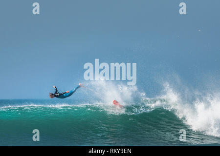 A surfing wipeout at Fistral in Newquay in Cornwall. - Stock Image