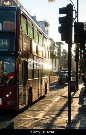 Contre jour image of a Red London Bus on Oxford street, London UK, Europe - Stock Image