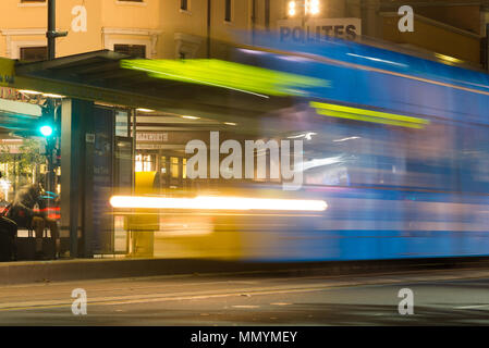 A tram makes a temporary stop in King William Street, Adelaide, South Australia, Australia. - Stock Image