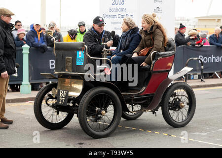 Ms Mary Crofton being interviewed, after successfully completing the 2018  London to Brighton veteran Car Run, driving a 1900, De Dion Buton. - Stock Image