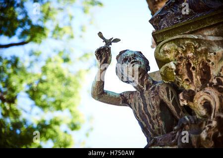 Boy on headstone at Père Lachaise Cemetery, Paris, France - Stock Image