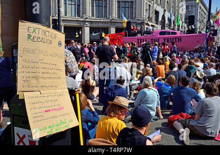 London, UK. 19th Apr 2019. Environmental campaign group Extinction Rebellion continue to stop occupy several locations around the city, to demand that the Government take emergency action on the climate and ecological crisis. Parliament Square Credit: PjrFoto/Alamy Live News - Stock Image
