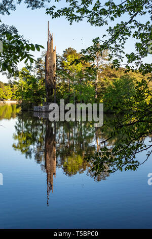 Lake view of the 732-bell redwood and steel Carillon at Stone Mountain Park in Atlanta Georgia. The 13-story carillon was donated by Coca-Cola. - Stock Image
