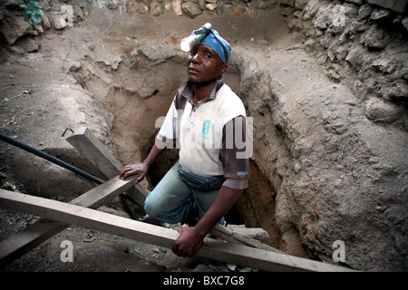Tanzanite miner  descending ladder mining Arusha tanzania - Stock Image