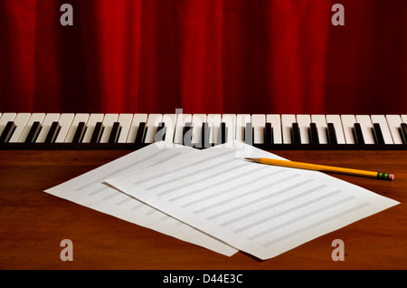 blank sheetmusic with pencil on piano - Stock Image
