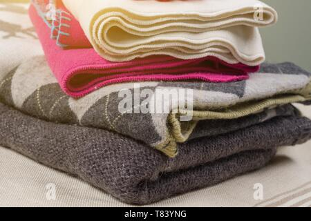 Winter time - Warm winter woolen clothes - knitted sweaters, scarves, gloves - Stock Image
