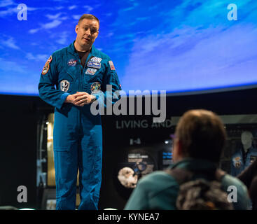 An audience member asks a question after a presentation by NASA astronaut Jack Fischer about his time onboard the - Stock Image