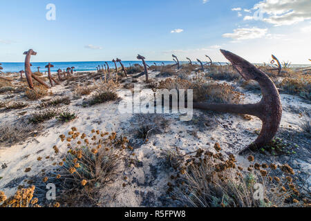Cemetery of Anchors. Memorial monument to dead fishermen of tuna industry in Portugal. Baril beach, Santa Luzia, Algarve - Stock Image