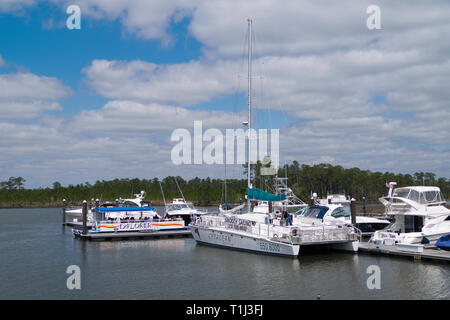 Cruise boats at dock in the Intracoastal Waterway near the Wharf shopping district in Orange Beach, Alabama, USA. - Stock Image