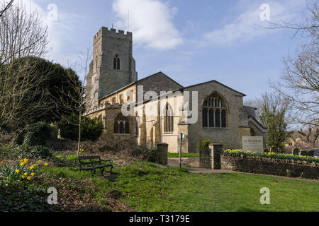 The parish church of St Nicholas in the village of Potterspury, Northamptonshire, UK; earlist parts date from 12th century with later restorations - Stock Image
