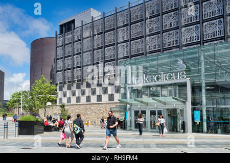 2 June 2018: Plymouth, Devon, UK - Drake Circus Shopping Centre on a bright and warm spring day, with shoppers entering and leaving. - Stock Image